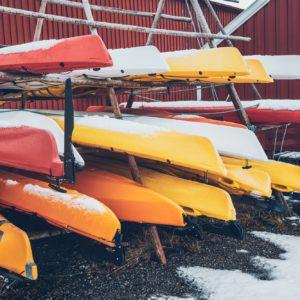 Kayaks in winter in Reine fishing village, Norway